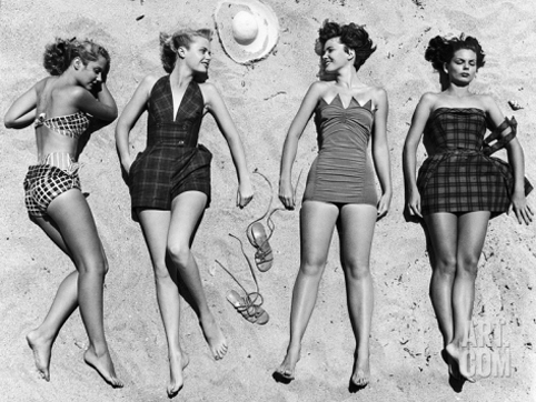 nina-leen-models-sunbathing-wearing-latest-beach-fashions